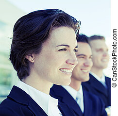 smiling business team - head and shoulders of three business...