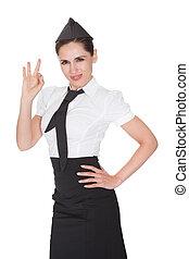 Stewardess making Ok hand gesture