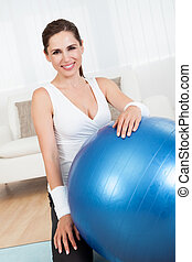 Happy woman with a pilates ball - Close up of a happy...