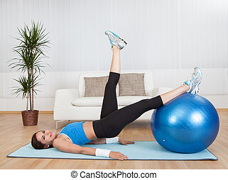 Woman Exercising With Exercise Ball - Attractive Woman...