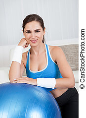 Woman Leaning On An Exercise Ball