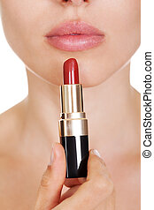 Attractive woman applying lipstick - Attractive woman with...