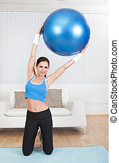 Woman Exercising With Exercise Ball