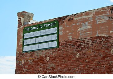 Welcome to Prosper on the side of an old building