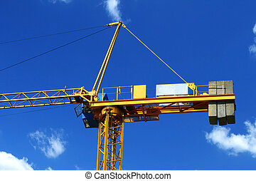 yellow crane #3 - yellow crane against sky with cumulus...