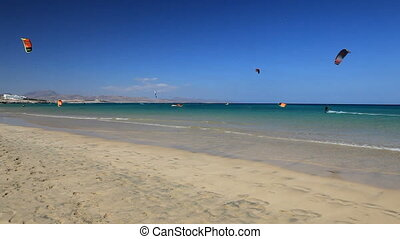 kite surfing - fuerteventura beach with kitesurfer