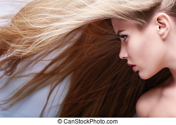 Hairstyle - Young girl with flying hair
