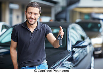 Man with car keys - Young man with the keys at the car