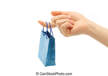Hand holds shopping bag on a white background