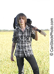 Teenage emo guitarist - Young rocker posing with musical...
