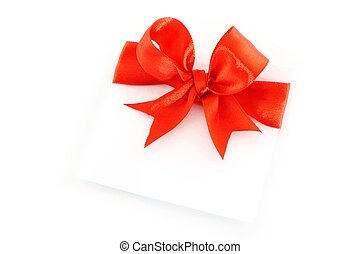 Sheet with red holiday bow on white background