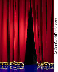 Opening in stage curtains with gold tassels