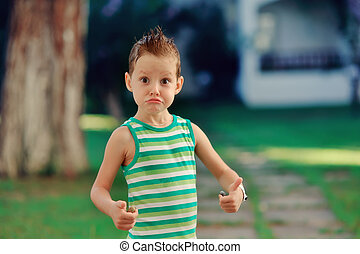 little dude - emotional boy in a green shirt with a stylish...