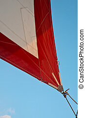 Red and White Jib - Corner of red and white jib sail with...