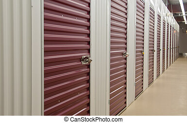Storage Units - interior of storage building showing rows of...