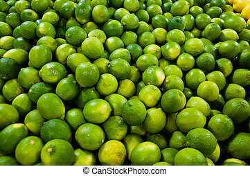 Limes   - Large bin at a farmer's market full of green limes