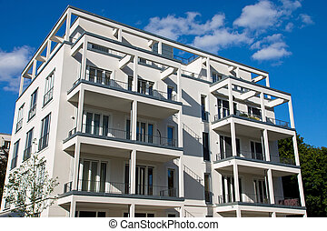 White modern townhouse - A white modern townhouse in front...