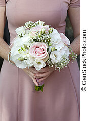 bridesmaid holding a wedding bouquet of pink flowers
