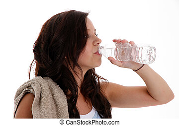 Teenager Drinking Water - Teen girl drinking water at the...