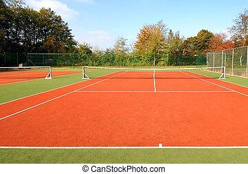 Tennis Court - tennis court under blue sky, with autumn...