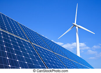 Renewable Energy - Solar panels and wind turbine against...
