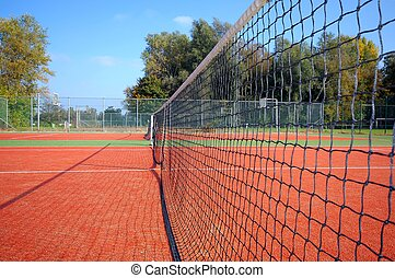 Tennis Court - tennis court under blue sky, with the net as...