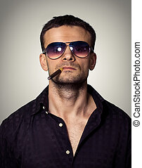Man in sunglasses with a cigar
