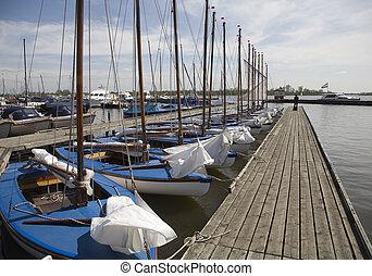 Sailing boats 1 - Many blue sailing boats in the marina