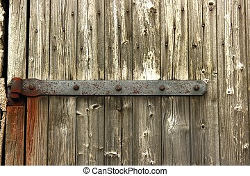 Rusted Hinge on Wooden Door