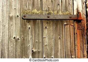 Plain Wooden Door With Rusty Hinge