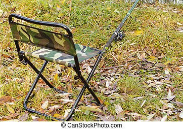 Fishing tackle ashore about a fishing chair - Fishing tackle...