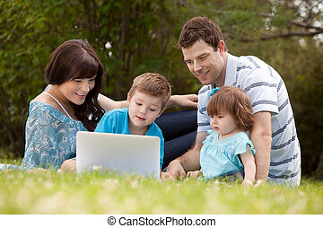 Family Outdoors with Computer