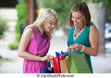 Friends Looking Into Shopping Bags