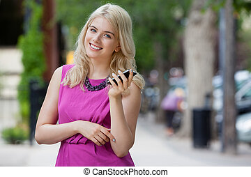 Woman Talking on Mobile Phone in City - Portrait of an...