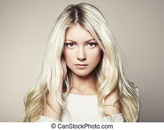 Photo of beautiful woman with magnificent hair. Fashion...
