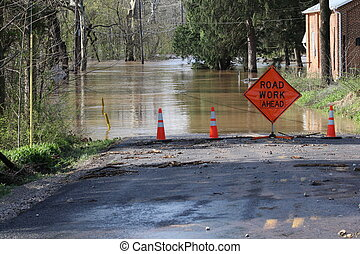 road work ahead - Flooded road with funny sign.