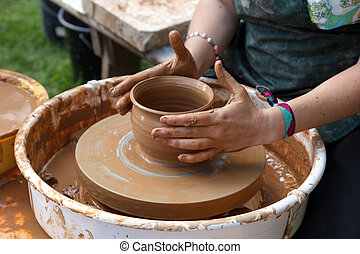 Potters Hands - Young potter makes a jug out of clay