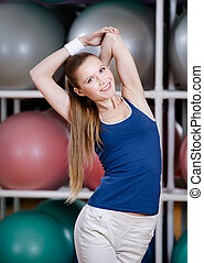 Athlete woman stretching herself - Athlete woman in...