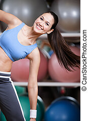 Athletic woman training with dumbbells - Sportswoman...
