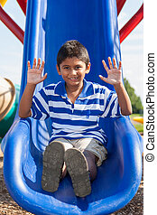 Portrait of a cute little indian boy at playground - Outdoor...