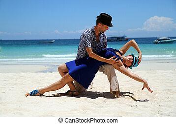 couple dancing near ocean