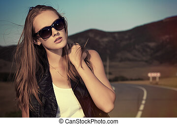 vacation - Beautiful young woman posing on a road over...