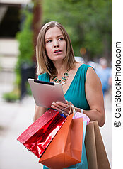 Shopping Woman holding Digital Tablet