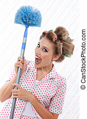 Humourous Woman with Duster - Funny retro woman holding blue...