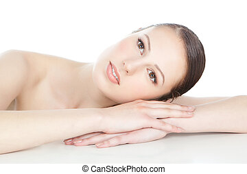 Beautiful woman face with clean skin over white