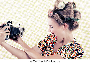 Woman holding a Vintage Camera - Woman holding a vintage 4x6...