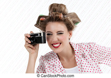 Woman with 35mm Camera - Portrait of retro styled attractive...