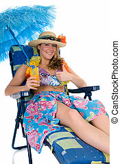 Relaxing woman, vacation - Attractive young woman in beach...