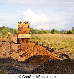 dumptruck - construction of roads, gravel truck unloads