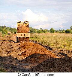 dumptruck - construction of roads, gravel truck unloads